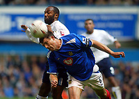 Fotball<br /> Foto: BPI/Digitalsport<br /> NORWAY ONLY<br /> <br /> 26/10/2004 <br /> <br /> Portsmouth v Leeds United<br /> <br /> Carling Cup Third round. 26/10/2004.<br /> <br /> Arjen De Zeeuw beats Julian Joachim to clear the ball from danger