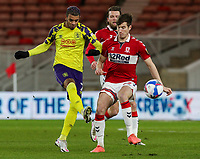 Huddersfield Town's Juninho Bacuna battles with Middlesbrough's Paddy McNair<br /> <br /> Photographer Alex Dodd/CameraSport<br /> <br /> The EFL Sky Bet Championship - Middlesbrough v Huddersfield Town - Tuesday 16th February 2021 - Riverside Stadium - Middlesbrough<br /> <br /> World Copyright © 2021 CameraSport. All rights reserved. 43 Linden Ave. Countesthorpe. Leicester. England. LE8 5PG - Tel: +44 (0) 116 277 4147 - admin@camerasport.com - www.camerasport.com