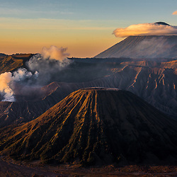 """Mount Bromo (Indonesian: Gunung Bromo) in early sunlight. Mount Bromo is an active """"live volcano"""" and part of the Tengger massif, in East Java, Indonesia. At 2,329 meters it is by far not the highest peak of the 400 volcanoes doting the Indonesian archipelago, but surly the most well known and quite easy to access. It is also possible to balance a motorbike through the """"Sea of Sand"""" – the volcanic ash of the vast plain."""