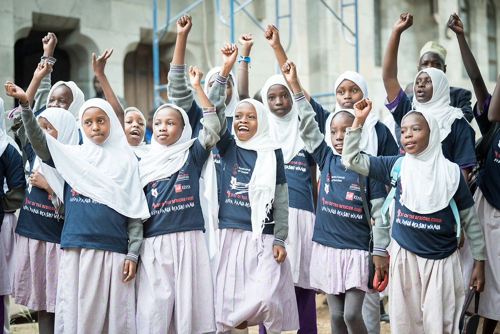 """16 June 2017, Nairobi, Kenya: Children from the Joseph Kangethe School, a public school for muslim and christian children of ages 2-13, participate in the commemoration of the Day of the African Child 2017, in Nairobi. On 16 June, more than 500 people gathered to commemorate the Day of the African Child in Nairobi, Kenya, and to speak up publicly for the rights of children and adolescents living with HIV. Religious leaders from a range of different faith communities and traditions led a march through the streets of Nairobi, from the All Saints Cathedral to Ufungamano House, accompanied by hundreds of youth and young children from local faith-sponsored schools, after which a ceremony was held where the religious leaders committed publicly to work for children's rights to HIV testing, access to treatment, and freedom from stigma and discrimination, to make sure that those who are in need of treatment are also able to stay on treatment. The day was organized by the World Council of Churches Ecumenical Advocay Alliance together with Inerela+ Kenya, with contributions from a range of other partners. At end of the ceremony, the WCC-EAA launched a global Call to Action entitled """"Act now for children and adolescents living with HIV"""", which was signed by the range of religious leaders."""