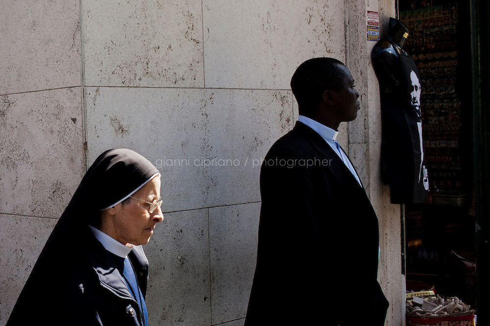ROME, ITALY - 9 MARCH 2013: A nun and a priest nearby Saint Peter's square in Rome, Italy, on March 9, 2013. <br /> <br /> <br /> <br /> Gianni Cipriano for The New York Times