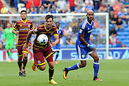 QPR's Grant Hill (l) chases Cardiff City's Frederic Gounongbe's flicked header. EFL Skybet championship match, Cardiff city v Queens Park Rangers at the Cardiff city stadium in Cardiff, South Wales on Sunday 14th August 2016.<br /> pic by Carl Robertson, Andrew Orchard sports photography.