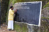 Indian Man Writing on Public Blackboard