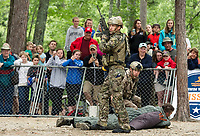 """The Navy Seal Team secured their suspect during a performance drill for the crowd at Wellington State Beach following the """"Swim With a Mission"""" event on Friday afternoon.  (Karen Bobotas/for the Laconia Daily Sun)"""