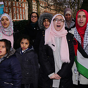 West Midlands Palestine Solidarity Campaign holds a rally with hundreds of protestors come from all over the county of UK to protest outside UN Embassy on the 6th January 2018 against Trump's recognition of Jerusalem as Israel's capital. Protestors shout slogan Jerusalem does not belong to the US or own by US 'Freedom for Palestine' in London, UK.