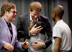 Prince Harry, Duke of Sussex and Sir Elton John at a plenary session to launch a new coalition of global Aids funders the MenStar Coalition during the Aids 2018 summit in Amsterdam, the Netherlands, Tuesday July 24, 2018. Photo by Robin Utrecht/ABACAPRESS.COM