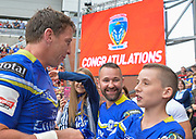Warrington Wolves Kurt Gidley chats with a young fan after the Ladbrokes Challenge Cup Semi-Final  match Warrington Wolves -V- Wakefield Trinity Wildcats at , Leigh, Greater Manchester, England on Saturday, July 30, 2016. (Steve Flynn/Image of Sport)