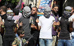 October 2, 2016 - Gaza City, The Gaza Strip, Palestine - Masked Islamic Jihad Movement supporters holds a molotov cocktail bottle during a military rally marking the first anniversary of the Al-Quds uprising in Gaza city. (Credit Image: © Mahmoud Issa/Quds Net News via ZUMA Wire)