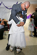 Omar Outten dances with his daughter at the Federal Detention Center Miami. For the first time ever, the federal prison system hosts a Daddy Daughter dance, a social for inmates and their daughters on Tuesday, November 4, 2014. For two hours, the dads spent time dancing and socializing with their daughters at a federal detention center in Miami. The move is part of a broader family reunification program to help prepare and encourage inmates once they leave the prison system. (Some of the faces of the subjects have been blurred to prevent identification, as agreed upon with prison authorities.)