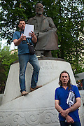 Moscow, Russia, 12/05/2012..A protester makes a speech under the statue of Kazakh poet Abai Kunanbaev in Chistiye Prudy, or Clean Ponds, a park in central Moscow were some 200 opposition activists have set up camp.