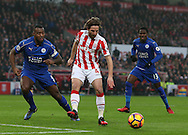 Joe Allen of Stoke City holds the ball from Wes Morgan of Leicester City during the English Premier League match at the Bet 365 Stadium, Stoke on Trent. Picture date: December 17th, 2016. Pic Simon Bellis/Sportimage