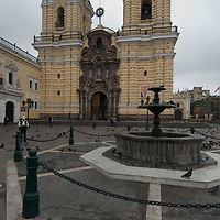 A fountain sits in the plaza by the Convent of San Francisco in Lima, Peru - where its catacombs were the site of mass burials.