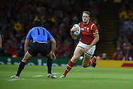 Cory Allen of Wales runs at Rodrigo Silva of Uruguay.Rugby World Cup 2015 pool A match, Wales v Uruguay at the Millennium Stadium in Cardiff, South Wales  on Sunday 20th September 2015.<br /> pic by  Andrew Orchard, Andrew Orchard sports photography.