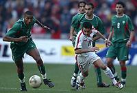 Fotball<br /> African Nations Cup 2004<br /> Afrika mesterskapet 2004<br /> Foto: Digitalsport<br /> NORWAY ONLY<br /> <br /> FINAL - 040214 <br /> TUNISIA v MOROCCO <br /> ABDESLAM OUADDOU (MAR) / SANTOS (TUN)  *** Local Caption *** 40001044