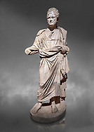 Roman statue of Emperor Priest. Marble. Perge. 2nd century AD. Inv no . Antalya Archaeology Museum; Turkey .  Against a grey background .<br /> <br /> If you prefer to buy from our ALAMY STOCK LIBRARY page at https://www.alamy.com/portfolio/paul-williams-funkystock/greco-roman-sculptures.html . Type -    Antalya     - into LOWER SEARCH WITHIN GALLERY box - Refine search by adding a subject, place, background colour, museum etc.<br /> <br /> Visit our ROMAN WORLD PHOTO COLLECTIONS for more photos to download or buy as wall art prints https://funkystock.photoshelter.com/gallery-collection/The-Romans-Art-Artefacts-Antiquities-Historic-Sites-Pictures-Images/C0000r2uLJJo9_s0