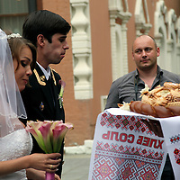Europe, Russia, Moscow. Traditional Russian Wedding bread  ceremony taking place outside the Tretyakov Museum.