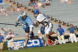 26 April 2009: North Carolina Tar Heels defends Duke defenseman CJ Costabile (9) during a 15-13 loss to the Duke Blue Devils during the ACC Championship at Kenan Stadium in Chapel Hill, NC.