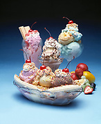 Studio photograph of various exciting ice cream deserts on a blue background