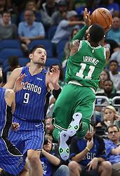 November 5, 2017 - Orlando, FL, USA - Boston Celtics guard Kyrie Irving (11) shoots over Orlando Magic center Nikola Vucevic (9) on Sunday, Nov. 5, 2017 at the Amway Center in Orlando, Fla. Boston won the game, 104-88. (Credit Image: © Stephen M. Dowell/TNS via ZUMA Wire)