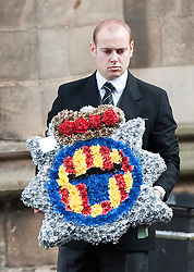 © London News Pictures. 10/03/2012.  Newcastle, UK. Flowers from Northumbia Police being taken from Newcastle Cathedral in Newcastle upon Tyne for a formal police memorial service in the memory of PC David Rathband, who was found dead in his Northumberland Home on February 29. PC David Rathband was left blind after being shot in the face by gunman Raoul Moat.  Photo credit : Ben Cawthra/LNP