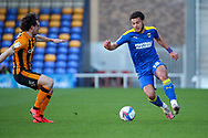 AFC Wimbledon defender Nesta Guinness-Walker (18) dribbling during the EFL Sky Bet League 1 match between AFC Wimbledon and Hull City at Plough Lane, London, United Kingdom on 27 February 2021.