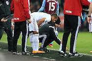 caption correction : Swansea city head coach Francesco Guidolin bends down and makes a point to Wayne Routledge as he marks on the pitch what he wants his players to do. Barclays Premier league match, Swansea city v Aston Villa at the Liberty Stadium in Swansea, South Wales on Saturday 19th March 2016.<br /> pic by  Andrew Orchard, Andrew Orchard sports photography.