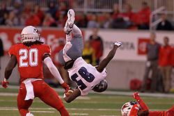 NORMAL, IL - September 08: Nick Atoyebi does a mid air flip when his advance is halted by Luther Kirk during 107th Mid-America Classic college football game between the ISU (Illinois State University) Redbirds and the Eastern Illinois Panthers on September 08 2018 at Hancock Stadium in Normal, IL. (Photo by Alan Look)