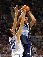 26/08/04 - ATHENS  - GREECE -  - BASKETBALL QUARTERFINAL MATCH   - Indoor Olympic Stadium - <br />ARGENTINA win (69) over GREECE (64) <br />Argentine celebration after win the match.<br />Here Arg. N*11 SCOLA LuisAlberto and Greece N*12 TSARTSARIS Konstantinos<br />© Gabriel Piko / Argenpress.com / Piko-Press