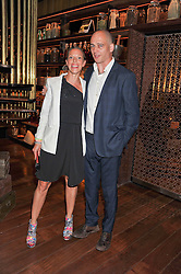 DINOS & TIPHAINE CHAPMAN at a dinner to celebrate the beginning of a unique partnership between The Naked Heart Foundation and W's Newest Hotel W St.Petersburg -The 'For Russia With Love' dinner was hosted by Sadie Frost and Natalia Vodianova at Spice Market restaurant, W London, Leicester Square, London on 2nd June 2011.
