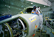 """Workers and aviation mechanics assemble a corporate jet aircraft. - MODEL RELEASED - Determine pricing and license this image, simply by clicking """"Add To Cart"""" below --"""
