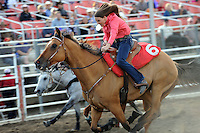 """Jennifer Domeno has got the fighting spirit during the lightning-fast Cowboy/Cowgirl race at Friday's """"Fight Hunger Night"""" events at the California Rodeo Salinas."""