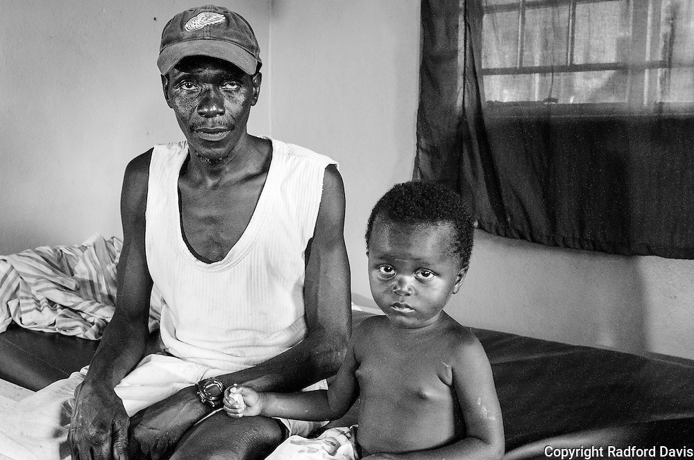 The health clinic in the village of Jimmi does what it can, with few supplies or equipment. Supplies are delivered by the Ministry of Health every 3 months, and requests for more go unfulfilled. Malaria, diarrhea, malnutrition are big problems. Here, a child is hospitalized for a fever. His father sits at his side.