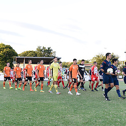 BRISBANE, AUSTRALIA - FEBRUARY 25: Brisbane Roar Youth and Olympic FC players walk out during the NPL Queensland Senior Men's Round 1 match between Olympic FC and Brisbane Roar Youth at Goodwin Park on February 25, 2017 in Brisbane, Australia. (Photo by Patrick Kearney/Olympic FC)
