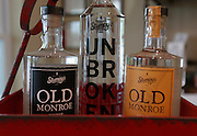 Two types of bourbon at left and right, with vodka at center. All made at Stumpy's Distillery.