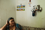 ALBERTVILLE, AL – AUGUST 19, 2014: Maria del Rosario Duarte Villanueva, 54, became the primary caretaker for her three grandchildren after both parents were deported to Mexico. One of her granddaughters requires regular medical assistance due to complications from birth. Villanueva is one of several undocumented immigrants filing applications for protection from deportation, in hopes to persuade President Obama to executive action.<br /> CREDIT: Bob Miller for The New York Times