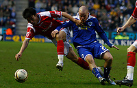 Photo: Steve Bond/Sportsbeat Images.<br /> Leicester City v Charlton Athletic. Coca Cola Championship. 29/12/2007. Zheng Zhi (L) and Iain Hume (R) tussle for the ball