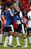 Photo: Chris Ratcliffe.<br />Charlton Athletic v Tottenham Hotspur. The Barclays Premiership. 01/10/2005.<br />Goal scorers Mido and Robbie Keane celebrate at the end of the game