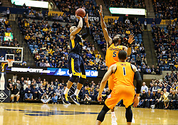 Feb 10, 2018; Morgantown, WV, USA; West Virginia Mountaineers guard Jevon Carter (2) shoots a three in the final minute of the game against the Oklahoma State Cowboys at WVU Coliseum. Mandatory Credit: Ben Queen-USA TODAY Sports