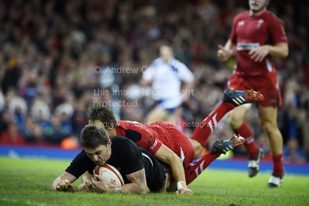 Beauden Barrett of NZ scores his teams 3rd try. Dove Men Series 2014, Wales v New Zealand , autumn international rugby match at the Millennium Stadium in Cardiff, South Wales on Saturday 22nd November 2014<br /> pic by Andrew Orchard, Andrew Orchard sports photography.