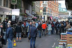 © Licensed to London News Pictures. 12/10/2015. London, UK. Sally Phillips and Renee Zellwegger (unseen) film Bridget Jones Diary in Borough Market. Photo credit: Peter Macdiarmid/LNP