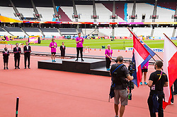 London, 03 August 2017. Volunteers stand on the podium as rehearsals are conducted for the medal ceremony ahead of the IAAF World Championships London 2017 at the London Stadium.