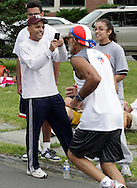 Middletown, New York - Edwin Estrada, left, takes a photograph of his grandfather Antonio Estrada near the finish line of the 15th annual Ruthie Dino Marshall 5K Run and Fun Walk hosted by the Middletown YMCA on Sunday, June 5,  2011.