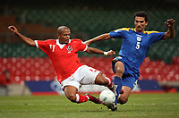 Photo: Rich Eaton.<br /> <br /> Wales v Cyprus. UEFA European Championships 2008 Qualifying. 11/10/2006. Robert Earnshaw left of Wales and Loukas Louka of Cyprus clash in the penalty box