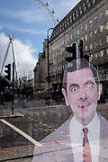 The character known as Mr Bean, one of the UKs successful TV comedy exports, looks out from a tourist trinket retailers window in Waterloo, where the London Eye still revolves while empty during the third lockdown of the Coronavirus pandemic, on 11th March 2021, in London, England.