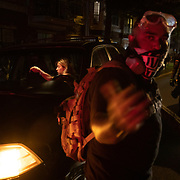 CHARLOTTE, NC - August 22:  A man directs traffic around a vehicle in the street during  a protest, organized by Charlotte Uprising, in uptown Charlotte near the site of the 2020 Republican National Convention in uptown Charlotte on August 22, 2020.  Delegates are holding private meetings inside the convention center ahead of the official start of the paired down convention on August 24th. (Photo by Logan Cyrus for AFP)