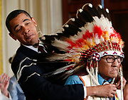 U.S. President Barack Obama presents the Medal of Freedom to Joe Medicine Crow - High Bird during a ceremony in the East Room at the White House in Washington, August 12, 2009.  The medal is the country's highest civilian honor.  REUTERS/Jim Young