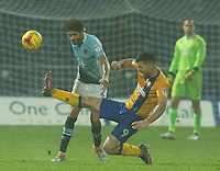 Kelvin Mellor of Blackpool clears the ball under pressure from Patrick Hoban of Mansfield Town<br /> <br /> Photographer James Williamson/CameraSport<br /> <br /> The EFL Sky Bet League Two - Mansfield Town v Blackpool - Tuesday 22nd November 2016 - One Call Stadium - Mansfield<br /> <br /> World Copyright © 2016 CameraSport. All rights reserved. 43 Linden Ave. Countesthorpe. Leicester. England. LE8 5PG - Tel: +44 (0) 116 277 4147 - admin@camerasport.com - www.camerasport.com