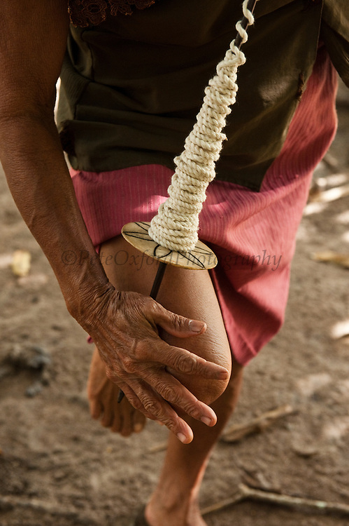 Amerindian Woman Spinning Cotton<br /> Apoteri Amerindian Village<br /> Rupununi<br /> GUYANA<br /> South America