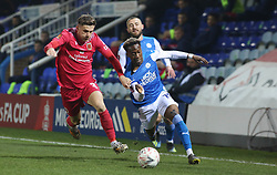 Siriki Dembele of Peterborough United takes on Arlen Birch of Chorley - Mandatory by-line: Joe Dent/JMP - 28/11/2020 - FOOTBALL - Weston Homes Stadium - Peterborough, England - Peterborough United v Chorley - Emirates FA Cup second round