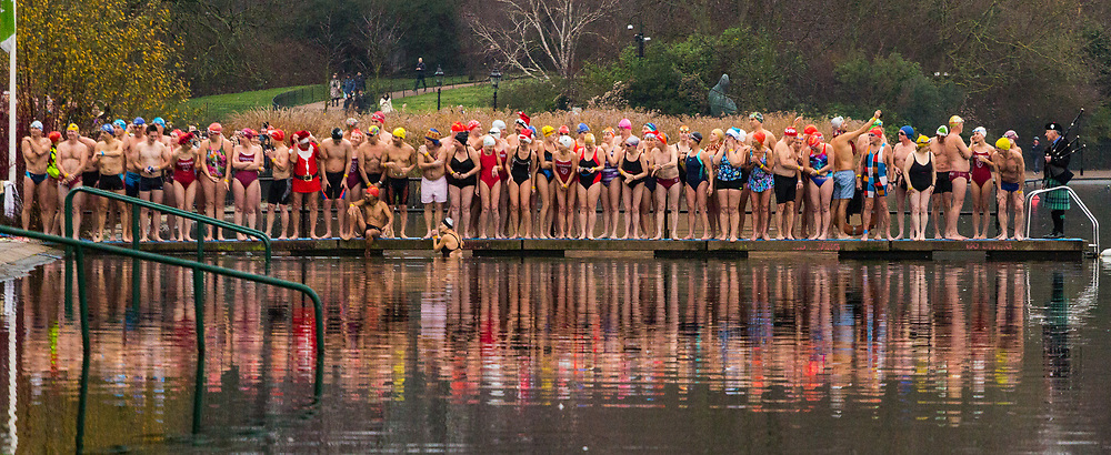 Swimmers take to the icy waters of the Serpentine in London's Hyde Park for the traditional Christmas Day Peter Pan Cup, a handicap race that sees the slowest swimmers starting first, cheered on by hundreds of spectators. London, December 25th 2018